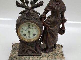 Reloj bronce base marmol